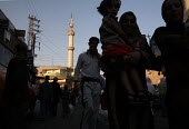 People passing by in front of a mosque in this area densely populated with Iraqi refugees. There is an estimated 1.4 million Iraqis who sought refuge in Syria due to the ongoing violence in their coun... - Morris Bernard - 30-08-2007