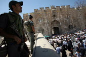 Israeli snipers posted at the old city entrance of the Lion gate watches thousands of Muslim worshippers heading to pray at the Al-Aqsa Mosque, East Jerusalem, September 14, 2007, for the first Friday... - Boris Heger - 14-09-2007