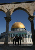 View of the Dome of the Rock, with shadowed passers by, near to the Al-Aqsa Mosque, East Jerusalem, September 2007. The sanctuary sheltering a stone believed to be the place from which the Prophet Muh... - Boris Heger - 11-09-2007