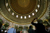 Interior view of the roof of the Dome of the Rock, near to the Al-Aqsa Mosque, with shadowed admirers, East Jerusalem, September 2007. The sanctuary sheltering a stone believed to be the place from wh... - Boris Heger - 11-09-2007