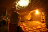 View of the underneath of the Dome of the Rock, near to the Al-Aqsa Mosque,with a worshipper, East Jerusalem, September 2007. The sanctuary sheltering a stone believed to be the place from which the P... - Boris Heger - 11-09-2007