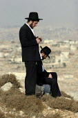 Jewish Orthodox settlers prey on a hill called Eitam, near Bethleem, where they want to establish an outpost settlement. Israeli settlers and rightwing groups announced that they would attempt to crea... - Morris Bernard - 30-09-2007