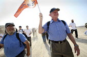 Jewish settlers march on the future site of the separation wall between in Israel and the West Bank, from the West Bank settlement of Efrat toward a hill called Eitam, near Bethleem, where they want t... - Morris Bernard - 30-09-2007