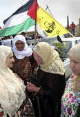 Relatives of Fifty-seven Palestinian prisoners, who have been released from an Israeli jail, discussing issues as they wait for them to arrive. They have been released as a Ramadan gesture of goodwill... - Morris Bernard - 01-10-2007
