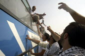Released Palestinian prisoners from an Israeli jail return elated and to a heroes welcome in Palestine as their relatives greet them off their bus. Fifty-seven Palestinian prisoners arrived back in th... - Morris Bernard - 01-10-2007