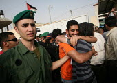 A former Palestinian prisoner, center, is greeted by relatives after being released from an Israeli jail as he arrives at Palestinian President Mahmoud Abbas headquarters in the West Bank city of Rama... - Morris Bernard - ,2000s,2007,arab,arabs,arms,asphalt,back,Bank,BANKS,checkpoint,clasping,conference,conferences,conflict,conflicts,Early,embrace,EMBRACING,emotion,EMOTIONAL,EMOTIONS,excited,families,family,free,freed,
