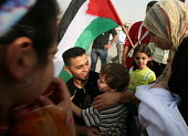 A former Palestinian prisoner (center) is greeted by his family, after being released from an Israeli jail. Fifty-seven Palestinian prisoners have been released and are welcomed back to Palestine as h... - Morris Bernard - 01-10-2007