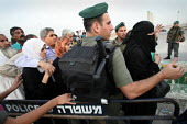 Palestinian Muslim worshippers waiting in a narrow pass at an Israeli army checkpoint by the barrier that separates the West Bank and Jerusalem. They are trying to reach Jerusalems Al Aqsa Mosque, whi... - Morris Bernard - 08-10-2007