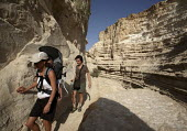 Foreign tourists walk the Zin river canyon, Ein Avdat National Park, Negev desert, Israel, October 2007. - Boris Heger - 19-10-2007
