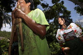 Tule performing traditional music. This village of Indigenous Tule have been displaced by conflict, to the Panama border region of the Darien gap. Their culture is based on a strong relationship with... - Boris Heger - @ACE#,2010,2010s,ace,americas,Amerindian,Amerindians,border,communities,community,conflict,costume,costumes,culture,Cuna,dance,dancer,dancers,dances,dancing,darien,Darien Gap,Darien National Park,disp