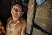 A Tule village chief, wearing a collar of monkey teeth he himself had hunted. This village of Indigenous Tule have been displaced by conflict, to the Panama border region of the Darien gap. Their cult... - Boris Heger - @ACE#,2010,2010s,ace,americas,Amerindian,Amerindians,border,conflict,culture,Cuna,darien,Darien Gap,Darien National Park,Department,displaced,displacement,Dule,EMOTION,EMOTIONAL,EMOTIONS,happiness,hap