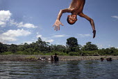 Children playing, jumping into the river. This village of Indigenous Tule have been displaced by conflict, to the Panama border region of the Darien gap. There are only a few thousands Tule left and t... - Boris Heger - 06-05-2010