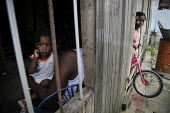 Internally displaced children playing in their poor neighbourhood. Coastal communities who live along the Pacific coast near the city of Buenaventura are in threat of further displacement due to confl... - Boris Heger - 03-07-2010