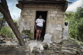 An internally displaced woman standing in front of her house in the poor suburb of Pozos Azules, Cartagena. - Boris Heger - 10-11-2010
