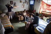 Internally displaced indigenous family in their home in a poor and dangerous neighbourhoor in Bogota, Colombia. - Boris Heger - 25-01-2011