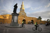 Police officers patrol with bikes on the streets of Cartagena, Colombia. At the colonial style El Reloj, or Clock Gate (built at the beginning of the 18th century by Juan de Herrera y Sotomayor) entra... - Boris Heger - 20-02-2011