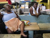 Merchants taking a rest after the rush at the fish market, Buenaventura, Colombia. - Boris Heger - 06-04-2011