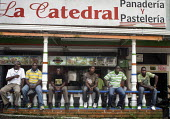 Unemployed youths sitting in front of a pastry shop in Buenaventura, Colombia. - Boris Heger - 06-04-2011