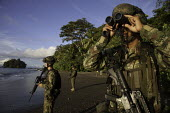 Colombian army soldiers anti narcotic patroling a beach and monitoring the movements of fast boats which could be smuggling cocaine. The pacific coast of Colombia is the main exit point for illegal ex... - Boris Heger - 18-08-2011