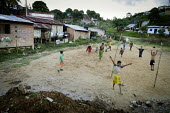 Children play football on a pitch located next to illegal gold mines. The Colombian government says it wants to control illegal mining and is giving licenses to big multinationals. Colombia is poised... - Boris Heger - 11-03-2012