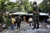 Police operation to close mines operated by small traditional miners. The Colombian government says it wants to control illegal mining and is giving licenses to big multinationals. Colombia is poised... - Boris Heger - ,2010s,2012,adult,adults,americas,Amerindian,Amerindians,anger,angry,armed,arms,CLJ,close,CLOSED,closing,closure,closures,Colombia,Colombian,Colombians,columbian,columbians,communicating,communication