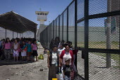 People queue to visit their relatives, Yanamilla prison, Ayacucho, Peru. Inmates at the Yanamilla prison of Ayacucho, Peru. Many of the prisoners have been convicted of offenses relating to coca culti... - Boris Heger - 10-10-2012