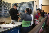 Visitors pass through safety checks as they queue to visit their relatives in the Yanamilla prison, Ayacucho, Peru. Many of the prisoners have been convicted of offenses relating to coca cultivation a... - Boris Heger - 10-10-2012