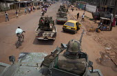 A column of the FOMAC (Multinational Force of Central Africa region) patrols the streets in an attempt to stabilize a volatile situation in Bangui, June 3, 2013, Central African Republic. Seleka forme... - Boris Heger - 2010s,2013,Africa,African,Africans,armed,Armed Forces,armored,armoured,arms,army,AUTO,AUTOMOBILE,AUTOMOBILES,AUTOMOTIVE,bloody,CAF140,car,carrier,CARS,Central,Central Africa,Central African Republic,c