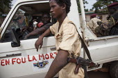 Seleka Sudanese child soldier in front of a 4x4 pickup truck whose door reads in french dont care about death, on June 4, 2013, Bangui, Central African Republic. Seleka former rebels took power in a b... - Boris Heger - 04-06-2013