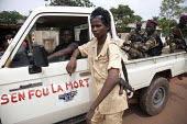Seleka Sudanese child soldier in front of a 4x4 pickup truck whose door reads in french dont care about death, on June 4, 2013, Bangui, Central African Republic. Seleka former rebels took power in a b... - Boris Heger - , Africa,2010s,2013,47,adolescence,adolescent,adolescents,africa,African,Africans,AK,AK 47,AK47,AK47S,armed,Armed Forces,arms,army,Assault Rifle,Assault Rifles,AUTO,AUTOMOBILE,AUTOMOBILES,AUTOMOTIVE,b