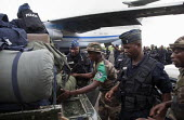 Congolese reinforcements for the FOMAC disembark with their baggage on an airstrip on June 4, 2013, in Bangui, Central African Republic. Seleka former rebels took power in a bloody coup on March 24th - Boris Heger - 04-06-2013