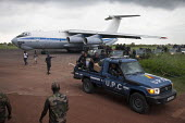 Congolese UPC reinforcements for the FOMAC disembark with their baggage on an airstrip June 4, 2013, in Bangui, Central African Republic. Seleka former rebels took power in a bloody coup on March 24th... - Boris Heger - 04-06-2013