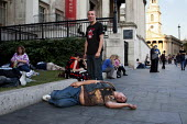 Drunk in the street, outside the National Gallery, Trafalga Square, London. - Connor Matheson - 03-10-2011
