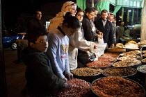 Buying seeds and nuts at the market, Amman, Jordan. - Connor Matheson - 2010s,2011,arab,arabic,arabs,bought,buy,buyer,buyers,buying,commodities,commodity,consumer,consumers,customer,customer customers,customers,EBF Economy,food,FOODS,goods,Jordanian,Jordanians,market,mark
