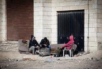 Palestinian refugees relax, refugee camp, Amman, Jordan. - Connor Matheson - 16-12-2011