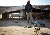 A Bedouin outside his tent with a cat, Amman, Jordan. - Connor Matheson - 18-12-2011