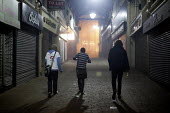 Three young men walk to the next club on a night out, Barnsley Centre. - Connor Matheson - 24-03-2012