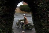 Pete takes his original WW2 motorbike out for a spin in front of his house. - Connor Matheson - , WW2,2010s,2012,2nd,bike,bikes,classic,collection,collector,collectors,enthusiast,enthusiasts,hobbies,hobby,hobbyist,Leisure,LFL,LIFE,male,man,men,motorbike,MOTORBIKES,motorcycle,motorcycles,motorcyc