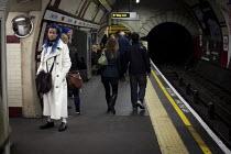 Waiting for a train, Chalk Farm, London. - Connor Matheson - LFL,2010s,2012,ACE,Chalk,cities,city,culture,EBF,Economic,Economy,Farm,fashion,fashionable,fashions,journey,journeys,Leisure,LFL,LIFE,male,man,men,network,passenger,passengers,PEOPLE,person,persons,pl