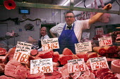 A butcher waiting for customers at Leeds Market. - Connor Matheson - 2010s,2012,butcher,butcher butchers,buy,buyer,buyers,buying,commodities,commodity,EBF Economy,goods,job,jobs,lbr work,Leeds,man men,meat,people,purchase,purchaser,purchasing,retail,RETAILER,RETAILERS,