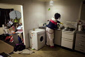 Doing the washing up. Olushola lives by her self at park hill flats and has done so on and off since she was 19. In April she was forced to move out in order to make way for the privatiseation and ren... - Connor Matheson - ,2010s,2012,BAME,BAMEs,BENIFIT,BENIFITS,Black,BME,bmes,cities,city,claimant,claimants,council estate,council services,council estate,council services,deprivation,diversity,EQUALITY,ethnic,ethnicity,ex