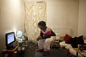 Olushola lives by her self at park hill flats and has done so on and off since she was 19. In April she was forced to move out in order to make way for the privatiseation and renovation of the estate. - Connor Matheson - ,2010s,2012,BAME,BAMEs,BENIFIT,BENIFITS,Black,BME,bmes,cities,city,claimant,claimants,communicating,communication,council estate,council services,council estate,council services,deprivation,diversity,