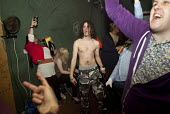 Young people have a good time at a rave, a free party in a disused factory, Wakefield. - Connor Matheson - 2010s,2013,ACE,alcohol,beer,binge,bodies,body,cities,city,club,clubbers,clubbing,clubs,culture,dance,dancer,dancers,dancing,disused,drink,drinker,drinkers,drinking,drinks,drug,drugs,drunk,drunken,drun