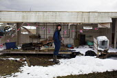 A young man in his back garden which he and his family have made into a small scrap yard. - Connor Matheson - 04-04-2013