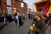 Union banner paraded through town, past boarded up housing, by the sons and grandchildren of ex miners on the day of Margaret Thatchers funeral, Goldthorpe, Barnsley. - Connor Matheson - 17-04-2013