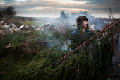 A young man burns waste in his back Garden farm/ scrapyard, Ryhill, Wakefield. Yorkshire - Connor Matheson - 10-12-2013