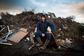 A Young man rests after working on his backyard farm and scrap yard, Ryhill wakefield. Yorkshire - Connor Matheson - 10-12-2013