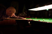 An ex miner has a game of snooker down his local working mens club, Ryhill, Wakefield. - Connor Matheson - 2010s,2013,adult,adults,age,ageing population,ball,balls,club,clubs,elderly,game,games,hobbies,hobby,hobbyist,Leisure,LFL,LIFE,local,male,man,MATURE,men,miner,MINERS,MINER'S,OAP,OAPS,old,older,PENSION