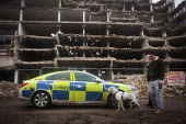 Young men get told to move on by police after salvaging scrap metal from a partially demolished building in Sheffield City Centre. - Connor Matheson - 2010s,2014,adult,adults,animal,animals,AUTO,AUTOMOBILE,AUTOMOBILES,AUTOMOTIVE,building,buildings,canine,CAR,cars,clJ,crime,demolish,DEMOLISHED,demolishing,demolition,developer,developers,DEVELOPMENT,d