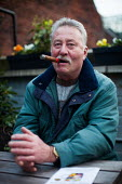 A man celebrates the weekend with a cigar in a Sheffield pub. - Connor Matheson - 2010s,2014,adult,adults,age,ageing population,cigar,cigars,elderly,Leisure,LFL,LICENSED,LIFE,male,man,MATURE,men,OAP,OAPS,old,older,PENSION,pensioner,pensioners,PENSIONS,PEOPLE,person,persons,pub,Publ